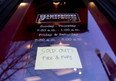 """Sign posted at the door for Kramerbooks & Afterwords Cafe indicating that the book """"Fire and Fury: Inside the Trump White House"""" is sold out at the bookstore located in the Dupont Circle neighborhood in Washington, Friday, Jan. 5, 2018. (AP Photo/Pablo Martinez Monsivais)"""
