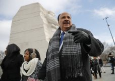 Martin Luther King III, right, with his wife Arndrea Waters, left, and their daughter Yolanda, 9, center, during their visit to the Martin Luther King Jr., Memorial on the National Mall in Washington, Monday, Jan. 15, 2018. The son of the late U.S. civil rights activist Martin Luther King Jr., and his family had earlier participated in an event commemorating the life and legacy of his father. (AP Photo/Pablo Martinez Monsivais)
