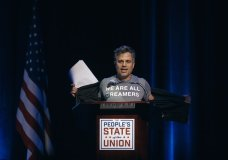 """Mark Ruffalo shows his T-shirt reading """"We are all dreamers"""" during the """"People's State of the Union"""" event at The Town Hall in New York, Monday, Jan. 29, 2018. (AP Photo/Andres Kudacki)"""