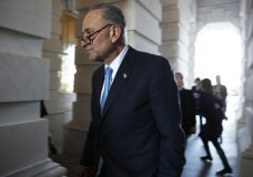 Senate Minority Leader Chuck Schumer, D-N.Y., center, walks into the Capitol after meeting with President Donald Trump, Friday, Jan. 19, 2018, in Washington. (AP Photo/Jacquelyn Martin)