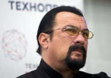 """FILE - In this Sept. 22, 2015, file photo, actor Steven Seagal speaks at a news conference, while attending an opening ceremony for a research and development center in Moscow, Russia. A once-aspiring actress has alleged Seagal raped her at a wrap party for the film """"On Deadly Ground,"""" claiming he undressed her and assaulted her on his bed while she focused on a photo of Seagal's wife on the nightstand. Regina Simons called the alleged assault """"very predatory, very aggressive and traumatizing"""" during an interview that aired Friday, Jan. 26, 2018 on """"Megyn Kelly Today."""" She was 18 at the time. (AP Photo/Ivan Sekretarev, File)"""