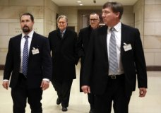 Former White House strategist Steve Bannon, second from left, is escorted from a House Intelligence Committee meeting where he was interviewed behind closed doors on Capitol Hill, Tuesday, Jan. 16, 2018, in Washington. (AP Photo/Jacquelyn Martin)
