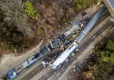 An aerial view of the site of an early morning train crash Sunday, Feb. 4, 2018 between an Amtrak train, bottom right, and a CSX freight train, top left, in Cayce, SC. The Amtrak passenger train slammed into a freight train in the early morning darkness Sunday, killing at least two Amtrak crew members and injuring more than 110 people, authorities said. (AP Photo/Jeff Blake)