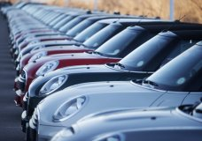 In this Sunday, Jan. 7, 2018, photograph, 2017 and 2018 Mini Coopers sit on a dealer's lot in Highlands Ranch, Colo. January 2018 U.S. auto sales are expected to grow just a little as rebates and other deals wane after a December buying spree. (AP Photo/David Zalubowski)
