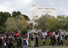 Police walk outside Marjory Stoneman Douglas High School in Parkland, Fla., Wednesday, Feb. 28, 2018. Students returned to class for the first time since a former student opened fire there with an assault weapon. (AP Photo/Terry Renna)