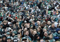 Fans cheer as they watch a replay of Super Bowl 52 in front of the the Philadelphia Museum of Art before a Super Bowl victory parade for the Philadelphia Eagles NFL football team, Thursday, Feb. 8, 2018, in Philadelphia. The Eagles beat the New England Patriots 41-33 in Super Bowl 52. (AP Photo/Alex Brandon)