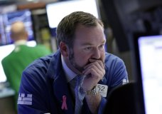 FILE- In this Monday, Feb. 5, 2018, specialists Charles Boeddinghaus works on the floor of the New York Stock Exchange. U.S. stocks swooned Friday and Monday as investors worried that accelerating inflation and higher interest rates could derail the market's record-setting rally. The wild swings Tuesday, Feb. 6, marked the third day of volatility in global markets. (AP Photo/Richard Drew, File)