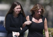 A young girl and a woman embrace as they leave a funeral service for Alyssa Alhadeff at the Star of David Funeral Chapel in North Lauderdale, Fla., Friday, Feb. 16, 2018. Alhadeff was one of the victims of Wednesday shooting at Marjory Stoneman Douglas High School. Nikolas Cruz, a former student, was charged with 17 counts of premeditated murder. (AP Photo/Brynn Anderson)