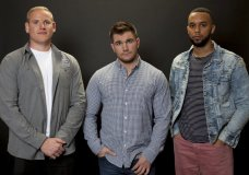 "In this Jan. 27, 2018 photo, Spencer Stone, from left, Alek Skarlatos, and Anthony Sadler, pose for a portrait to promote the film ""15:17 to Paris"" at the Four Seasons Hotel in Los Angeles. The trio, who famously thwarted a potential terrorist attack in August 2015 on a Paris-bound train, play themselves in the film. (Photo by Rebecca Cabage/Invision/AP)"