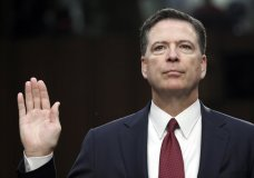 """FILE - In this June 8, 2017 file photo, former FBI Director James Comey is sworn in during a Senate Intelligence Committee hearing on Capitol Hill in Washington. On March 13, 2018, ABC announced the former FBI director would appear on """"The View"""" talk show. (AP Photo/Alex Brandon, File)"""
