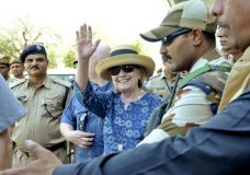 Former U.S. Secretary of State Hillary Clinton, center, waves as she comes out of the Jodhpur airport upoon her arrival in Jodhpur, Rajasthan state, India, Tuesday, March 13, 2018. (AP Photo/Sunil Verma)
