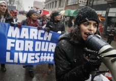 """Organizer Rasleen Krupp, 17, Wyoming High School, leads a """"March for Our Lives"""" protest for gun legislation and school safety, Saturday, March 24, 2018, in Cincinnati. Students and activists across the country planned events Saturday in conjunction with a Washington march spearheaded by teens from Marjory Stoneman Douglas High School in Parkland, Fla., where over a dozen people were killed in February. (AP Photo/John Minchillo)"""