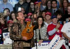 "FILE - In this Nov. 7, 2016 file photo, musician Ted Nugent performs before Republican presidential candidate Donald Trump comes on stage for his campaign rally before the general election, in the Grand Gallery at DeVos Place in Grand Rapids, Mich. Nugent says the Florida students calling for gun control have ""no soul"" and are ""mushy brained children."" He made the comments Friday while defending the National Rifle Association as a guest on the Joe Pags Show, a nationally syndicated conservative radio program. Nugent, an NRA board member, said survivors of the Parkland school shooting are wrong to blame the NRA for mass shootings.(Joel Bissell/The Grand Rapids Press via AP, File)"