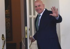 FILE - In this March 16, 2018, file photo. National security adviser H.R. McMaster waves as he walks into the West Wing of the White House in Washington. President Donald Trump announced on Twitter on March 22, 2018, that McMaster is being replaced by former U.N. Ambassador John Bolton. (AP Photo/Susan Walsh, File)