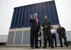 FILE - In this March 13, 2018 file photo, President Donald Trump talks with reporters as he reviews border wall prototypes in San Diego. Trump is floating the idea of using the military's budget to pay for his long-promised border wall with Mexico. Trump raised the idea to House Speaker Paul Ryan at a meeting last week, according to a person familiar with the discussion who spoke on condition of anonymity. (AP Photo/Evan Vucci, File)