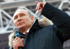 Russian President Vladimir Putin gestures while speaking during a massive rally in his support as a presidential candidate at the Luzhniki stadium in Moscow, Russia, Saturday, March 3, 2018. (Alexei Druzhinin, Sputnik, Kremlin Pool Photo via AP)