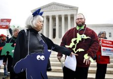"""Helenmary Ball, left, of Calvert County, Md., as """"Maryland District 5,"""" points toward the separated area of Maryland District 3, being represented by Bobby Bartlett, right, as nonpartisan groups against gerrymandering protest in front of the Supreme Court, Wednesday, March 28, 2018, in Washington where the court will hear arguments on a gerrymandering case. The Supreme Court is taking up its second big partisan redistricting case of the term amid signs the justices could place limits on drawing maps for political gain. T(AP Photo/Jacquelyn Martin)"""