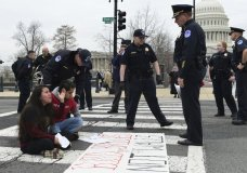 Protesters are arrested as they block the streets near the Capitol and the Supreme Court in Washington, Thursday, March 1, 2018. It's taken just two weeks for Washington's battle over helping young immigrants to fade from blistering to back-burner. Congress now seems likely to do little or nothing this election year on an effort that's been eclipsed by Congress' new focus on guns, bloodied by Senate defeats and relegated to B-level urgency by a Supreme Court ruling. (AP Photo/Susan Walsh)