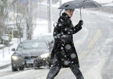 A pedestrian makes his way through the snowstorm that hit the east coast, including Greenwich, Conn., Wednesday, March 7, 2018. Gov. Dannel P. Malloy has signed an order banning tractor-trailers and tandem trailers on Connecticut highways to help neighboring New York manage its traffic as highway conditions worsen because of the nor'easter. (Bob Luckey Jr./Hearst Connecticut Media via AP)