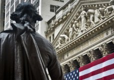 FILE - In this July 8, 2015, file photo, Federal Hall's George Washington statue stands near the flag-covered pillars of the New York Stock Exchange. The U.S. stock market opens at 9:30 a.m. EDT on Friday, March 23, 2018. (AP Photo/Bebeto Matthews, File)