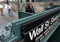 FILE- In this Oct. 2, 2014, file photo, the Wall Street subway stop on Broadway, in New York's Financial District. The U.S. stock market opens at 9:30 a.m. EDT on Wednesday, March 28, 2018. (AP Photo/Richard Drew, File)