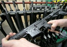 "FILE - In this April 10, 2013 file photo, craftsman Veetek Witkowski holds a newly assembled AR-15 rifle at the Stag Arms company in New Britain, Conn. A ruling released Friday, April 6, 2018, by a federal judge in Boston, dismissed a lawsuit challenging Massachusetts' ban on assault weapons and large-capacity magazines, stating that assault weapons are beyond the scope of the Second Amendment right to ""bear arms."" (AP Photo/Charles Krupa, File)"