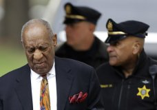 Bill Cosby, left, arrives for his sexual assault trial, Thursday, April 19, 2018, at the Montgomery County Courthouse in Norristown. (AP Photo/Matt Slocum)