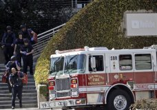 Emergency and law enforcement personnel exit YouTube headquarters, Tuesday, April 3, 2018, in San Bruno, Calif. A woman opened fire at YouTube headquarters Tuesday, setting off a panic among employees and wounding several people before fatally shooting herself, police and witnesses said. (AP Photo/Marcio Jose Sanchez)