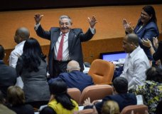 Outgoing President Raul Castro raises his arms in celebration after Miguel Diaz-Canel was elected as the island nation's new president, at the National Assembly in Havana, Cuba, Thursday, April 19, 2018. Castro passed Cuba's presidency to Diaz-Canel, putting the island's government in the hands of someone outside the Castro family for the first time in nearly six decades. He remains head of the powerful Communist Party that oversees political and social activities. (Adalberto Roque/Pool via AP)