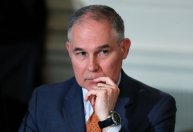 """In this Feb. 12, 2018 photo, Environmental Protection Agency Administrator Scott Pruitt attends a meeting at the White House in Washington. Trump is offering his support to the head of the Environmental Protection Agency who is at the center of swirling ethics questions. Two administration officials confirmed that the president called Scott Pruitt on Monday and told him that """"we've got your back."""" (AP Photo/Carolyn Kaster)"""