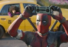 "FILE - This image released by Twentieth Century Fox shows Ryan Reynolds in a scene from ""Deadpool 2."" Fox's ""Deadpool 2"" brought in $125 million according to studio estimates Sunday, May 20, 2018, and ended the three-week reign of Disney's ""Avengers: Infinity War"" at the top of the North American box office. (Twentieth Century Fox via AP, File)"
