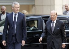 French Finance Minister Bruno Le Maire, left, welcomes US Secretary of Commerce Wilbur Ross prior to their meeting at French Economy Ministry in Paris, France, Thursday, May 31, 2018. U.S. tariffs on European steel and aluminum imports are expected after Trump administration's failure to win concessions from EU. (AP Photo/Francois Mori)