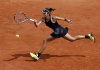 Spain's Garbine Muguruza returns the ball to France's Fiona Ferro during their second round match of the French Open tennis tournament at the Roland Garros stadium, Thursday, May 31, 2018 in Paris. (AP Photo/Michel Euler)