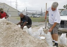 Gulfport, Miss., residents shovel sand into bags at a Harrison County Road Department sand bagging location, while preparing for Subtropical Storm Alberto to make its way through the Gulf of Mexico, Saturday, May 26, 2018. The slow moving storm is threatening to bring heavy rainfall, storm surges, high wind and flash flooding this holiday weekend. (AP Photo/Rogelio V. Solis)
