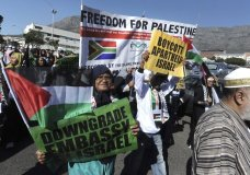 Protesters take part in a march to parliament in Cape Town, South Africa, Tuesday, May 15, 2018, to protest against the use of the deadly force used by Israeli troops against Palestinians at the Gaza border on Monday. Scores of people were killed and more than two thousand were injured in protests as the US opened its controversial new embassy in contested Jerusalem. (AP Photo/Nasief Manie)