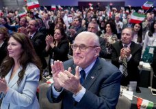 Rudy Giuliani, an attorney for President Donald Trump, applauds as a video is displayed before he speaks at the Iran Freedom Convention for Human Rights and democracy at the Grand Hyatt, Saturday, May 5, 2018, in Washington. (AP Photo/Andrew Harnik)