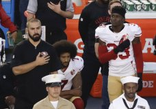 """FILE - In this Thursday, Sept. 1, 2016, file photo, San Francisco 49ers quarterback Colin Kaepernick, middle, kneels during the national anthem before the team's NFL preseason football game against the San Diego Chargers, in San Diego. NFL owners have approved a new policy aimed at addressing the firestorm over national anthem protests, permitting players to stay in the locker room during the """"The Star-Spangled Banner"""" but requiring them to stand if they come to the field. The decision was announced Wednesday, May 23, 2018, by NFL Commissioner Roger Goodell during the league's spring meeting in Atlanta.(AP Photo/Chris Carlson, File)"""