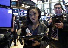 Trader Lauren Simons works on the floor of the New York Stock Exchange, Monday, May 21, 2018. Stocks are opening solidly higher on Wall Street after trade tensions between the U.S. and China dissipated. (AP Photo/Richard Drew)