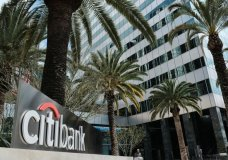 FILE - This March 23, 2018 file photo shows the entrance to Citibank at the Citigroup Center in downtown Los Angeles. On Friday, June 29, 2018, Citigroup said it plans to refund $335 million to a group of customers who may have been overpaying interest on their credit cards. (AP Photo/Richard Vogel, File)