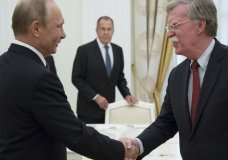 Russian President Vladimir Putin, left, and U.S. National security adviser John Bolton greet each other as Russian Foreign Minister Sergey Lavrov, center, looks at them during the meeting in the Kremlin in Moscow, Russia, Wednesday, June 27, 2018. Bolton is meeting Putin for talks intended to set the stage for a U.S.-Russia summit. (AP Photo/Alexander Zemlianichenko, Pool)