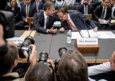 Deputy Attorney General Rod Rosenstein, right, and FBI Director Christopher Wray, left, arrive to testify before a House Judiciary Committee hearing on Capitol Hill in Washington, Thursday, June 28, 2018, on Justice Department and FBI actions around the 2016 presidential election. (AP Photo/Andrew Harnik)