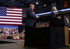 President Donald Trump points towards North Dakota Senate candidate Rep. Kevin Cramer, R-N.D., during a campaign rally, Wednesday, June 27, 2018, in Fargo, N.D. (AP Photo/Evan Vucci)