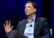 FILE - In this April 30, 2018, file photo, former FBI director James Comey speaks during a stop on his book tour in Washington. Comey is about to get dinged in an internal review by the Justice Department, and President Donald Trump says he can't wait. (AP Photo/Jose Luis Magana, File)