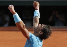 Spain's Rafael Nadal celebrates winning his semifinal match of the French Open tennis tournament against Argentina's Juan Martin del Potro in three sets 6-4, 6-1, 6-2, at the Roland Garros stadium in Paris, France, Friday, June 8, 2018. (AP Photo/Michel Euler)