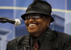 FILE - In this June 2, 2010 file photo, Joe Jackson, father of the late Michael Jackson, laughs during a news conference about the construction of the proposed Michael Jackson Performing Arts and Cultural Center and Museum, in Gary, Ind. Jackson, the patriarch of America's most famous musical clan has died, says a family source on Wednesday, June 27. He was 89. (AP Photo/John Smierciak)