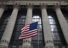 FILE- In this April 24, 2018, file photo, an American flag flies outside the New York Stock Exchange in New York. The U.S. stock market opens at 9:30 a.m. EDT on Tuesday, June 5. (AP Photo/Mary Altaffer, File)