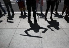 Protesters cast their shadows as they chant slogans during a rally outside the the Millennium Biltmore Hotel Tuesday, June 26, 2018, in Los Angeles. U.S. Attorney General Jeff Sessions is scheduled to give a speech at the hotel. (AP Photo/Jae C. Hong)