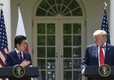 President Donald Trump, right, listens as Japanese Prime Minister Shinzo Abe, left, speaks during a news conference in the Rose Garden of the White House in Washington, Thursday, June 7, 2018. (AP Photo/Susan Walsh)