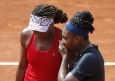 Serena Williams of the U.S., right, and her sister Venus Williams plays Slovenia's Andreja Klepac and Spain's Maria Jose Martinez Sanchez during their double match of the French Open tennis tournament at the Roland Garros stadium, Sunday, June 3, 2018 in Paris. (AP Photo/Michel Euler)