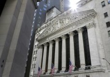 FILE- This June 25, 2018 file photo shows the New York Stock Exchange in New York. Stocks are opening broadly higher on Wall Street, Tuesday, July 31, 2018, as technology companies rise after a three-day losing streak. Industrial companies were also higher (AP Photo/Seth Wenig, File)